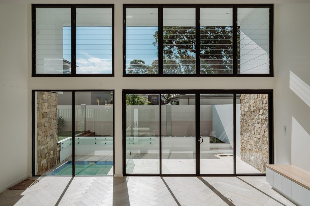 couvaras architects dual occupancy interior living room pool courtyard